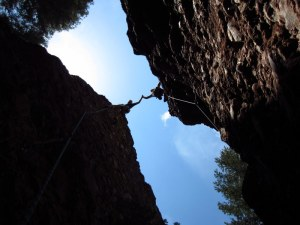 2 Climbers Reaching