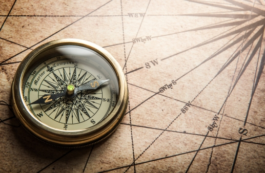 Compass on old map (Shutterstock)